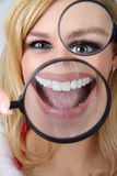 Beautiful woman with magnifying glass Royalty Free Stock Photography