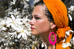 Beautiful woman among of magnolia Royalty Free Stock Photography