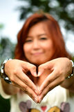 Beautiful woman make heart shape with hand Stock Photo