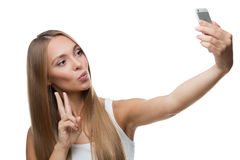 Beautiful woman make selfie on white background Royalty Free Stock Image