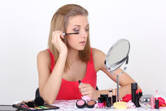 Beautiful woman with make up accessories and mirror Royalty Free Stock Photos