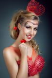 Beautiful woman with make-up and body-art styled as playing card Stock Photos