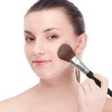 Beautiful woman with make up brush Royalty Free Stock Image