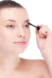 Beautiful woman with make up brush Royalty Free Stock Photography