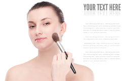 Beautiful woman with make up brush Stock Image