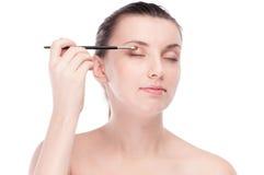 Beautiful woman with make up brush Royalty Free Stock Photo