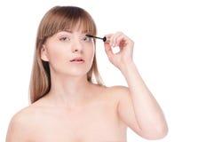 Beautiful woman with make up brush Stock Photo