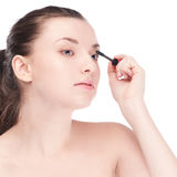 Beautiful woman with make up brush Stock Image