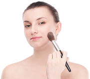 Beautiful woman with make up brush Royalty Free Stock Photos