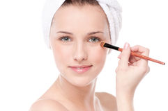 Beautiful woman with make up brush Stock Images