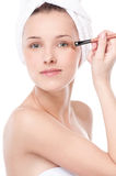 Beautiful woman with make up brush Stock Photo