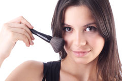 Beautiful woman with a make-up brush. Isolated Royalty Free Stock Photo