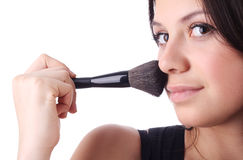 Beautiful woman with a make-up brush. Isolated Stock Photo