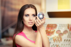 Beautiful Woman with Make-up Brush Looking in a Mirror Royalty Free Stock Photos