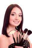 Beautiful  woman with make-up brushes Stock Images