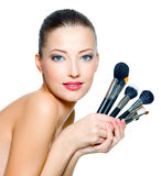 Beautiful woman with make-up brushes Stock Photo