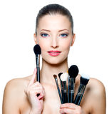 Beautiful woman with make-up brushes Royalty Free Stock Image