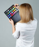 Beautiful woman with make up brushes and palette Stock Image