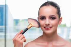 The beautiful woman during make-up cosmetics session Stock Photo