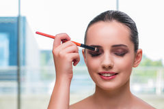 The beautiful woman during make-up cosmetics session Royalty Free Stock Photos