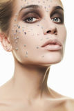 Beautiful woman make-up with crystals on face stock photography