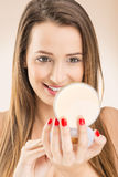 Beautiful woman with make-up mirror and makeup brush Royalty Free Stock Image