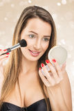 Beautiful woman with make-up mirror and makeup brush Royalty Free Stock Photography