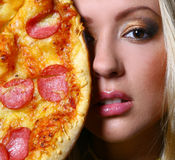 Beautiful woman with make-up and pizza Stock Photography