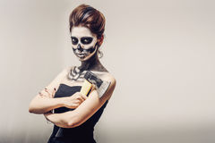 Beautiful woman with make-up skeleton. Beautiful girl with creative make-up for the Halloween party Stock Photography