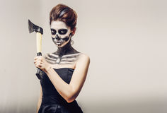 Beautiful woman with make-up skeleton. Beautiful girl with creative make-up for the Halloween party Royalty Free Stock Photo