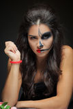 Beautiful woman with make-up skeleton. half-face stock image