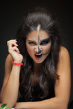 Beautiful woman with make-up skeleton. half-face Royalty Free Stock Photo