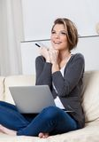 Beautiful woman makes purchases through the internet Royalty Free Stock Photography