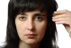 Beautiful woman makes up eyelashes Stock Photo