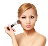 Beautiful woman with makeup brush isolated on white. Blonde girl Royalty Free Stock Image