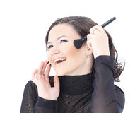 Beautiful woman with makeup brush Royalty Free Stock Image
