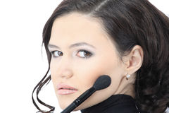 Beautiful woman with makeup brush Royalty Free Stock Images