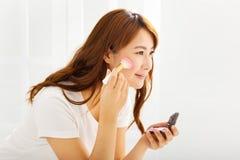 beautiful woman with Makeup Brush Royalty Free Stock Image