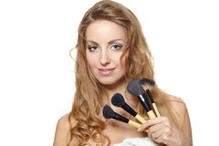 Beautiful woman with makeup brushes Royalty Free Stock Images