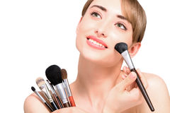 Beautiful woman with makeup brushes - isolated Royalty Free Stock Image