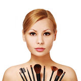 Beautiful woman with makeup brushes, isolated Stock Images