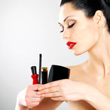 Woman with makeup cosmetic tools near her face. Royalty Free Stock Image