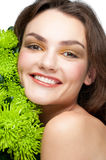 Beautiful woman with makeup and flowers Stock Images