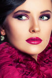 Beautiful Woman with Makeup and Flowers. Face Closeup Royalty Free Stock Photography