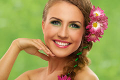 Beautiful woman with makeup and flowers Royalty Free Stock Image