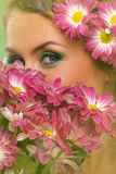 Beautiful woman with makeup and flowers Royalty Free Stock Photography