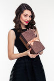 Beautiful woman with makeup in retro style holding present box Stock Photo