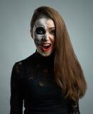 Beautiful woman with makeup skeleton dumbfounded stock photos