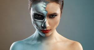 Beautiful woman with makeup skeleton half stock photo