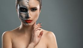 Beautiful woman with makeup skeleton royalty free stock photos